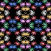 Contrasting symmetric arranged multicolored shapes on black background — Stock Photo
