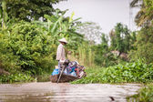 Vietnamese woman on a boat — Stock Photo