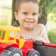 A little boy, two years old, smiling, summer, naked to the waist — Stock Photo #74360479
