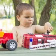 A little boy, two years old, smiling, summer, naked to the waist — Stock Photo #74360573