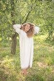 Young girl, Ukrainian national costume, standing barefoot on the — Stock Photo