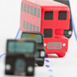 Traffic: three car and one bus (focus on the bus) — Foto de Stock   #59865739