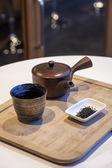 Japanese tea set with tea leaf on wooden tray — Stock Photo