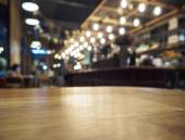 Top of Wooden Table with Blurred Bar restaurant Background — Stock Photo
