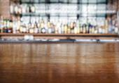 Top wooden table with restaurant Bar Blurred Background — Foto de Stock