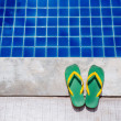 Flip flops by the Pool Summer Holiday Background — Stock Photo #66118463