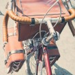 Vintage touring bicycle with bags top view — Stock Photo #75605667