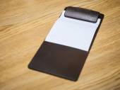 Blank Bill Receipt Clip in pad on Table — Stock Photo