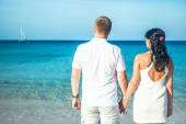 Happy Loving couple on a tropical beach against the sea Similan Island — Stock Photo