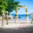 Exotic ceremony wedding european style arch on the tropical beach — Stock Photo #61917349