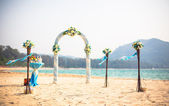 Exotic Wedding ceremony on the shore of the ocean sea arch on the beach — Stock Photo