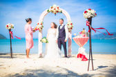 Wedding ceremony in the European style with an arch on the ocean — Stock Photo