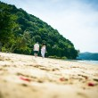Happy Loving couple on a tropical beach against the sea Similan Island — Stock Photo #62678281