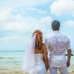 Happy Loving couple on a tropical beach against the sea Similan Island — Stock Photo #62679797