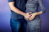 Hands on pregnant abdomen — Stock Photo
