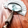 Dollars and magnifying glass — Stock Photo #64588033