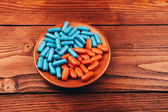 Pills on wooden table — Stock Photo