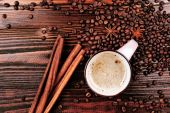 Coffee with coffee beans and cinnamon — Stock Photo