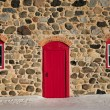 Old Stone Barn with Bright Red Door and Two Windows — Stock Photo #60153205