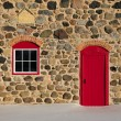 Old Stone Barn with Bright Red Door and Three Windows — Stock Photo #60205725