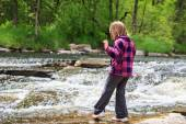 Young Girl Dipping Her Toe in the Water — Stock Photo