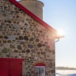 Old Stone Barn with Bright Red Door and Sunflare — Stock Photo #60541741
