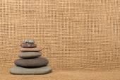 Stone Cairn on Burlap Background — Stock Photo