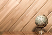 Old World Globe Against Plank Wall with Copy Space — Stockfoto