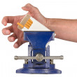 Vices - Hand Grabbing for Cigarettes Held in a Vise Grip — Stock Photo #70592965