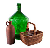 Large bottle a jug and a basket — ストック写真