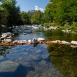 Dam from stones on the mountain river — Stock Photo #60919953