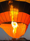 Burner directing a flame into balloon — Stock Photo