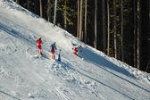 Downhill skiers on  piste — Stock Photo