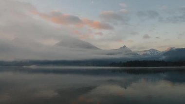 Clouds and fog moving over the lake — Stock Video