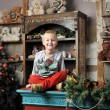 Christmas boy around the Christmas tree with gifts and toys Tedd — Stock Photo #64642213