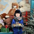 Christmas boy around the Christmas tree with gifts and toys Tedd — Stock Photo #64642313