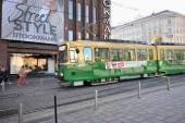 Helsinki, Finland, 28 September: green tram and urban life cente — Stock Photo