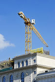 Crane construction completes attic — Stock Photo