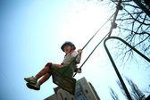 Baby girl on swing — Stock Photo