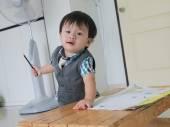 Portrait of cute boy writing — Foto Stock