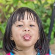 Little asian girl sticking the tongue out — Zdjęcie stockowe #60247701