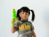 Girls in military uniform holding a gun on a white background. — Stock Photo