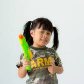 Girls with guns in military dress and smiling on a white background — Stock Photo