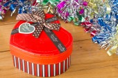 Gift box with ribbon on a wooden table. — Stock Photo