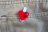 Red heart clothes peg on jeans — Stok fotoğraf