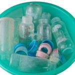 Bottles in a plastic bucket — Stock Photo #67746829