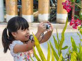 Image of a little girl holding camera  — Stock Photo