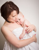 Young Mother In Intimate Cuddle With Her Baby — Stock Photo