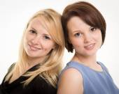 Two Beautiful Smiling Sisters Against A White Background — Stock Photo
