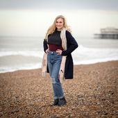Confident Blond Teenage Girl Alone on a Cold Beach — Stock Photo